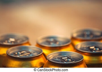 Beer cans, selective focus - Beer cans on rustic wooden...