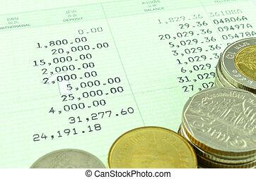 Saving account passbook with Thai coins - Closeup saving...
