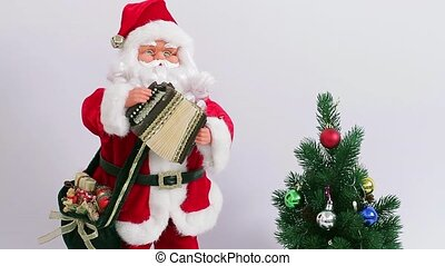 Christmas Santa Claus. - Santa playing the accordion near...