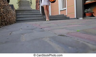 Girl on the heels. - Girl on the heels scattered the oranges...