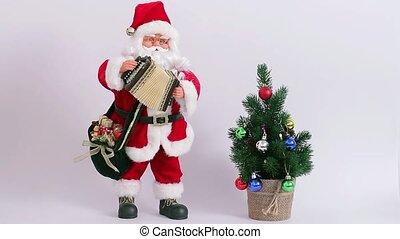 Christmas Santa Claus. - Santa playing the accordion near...