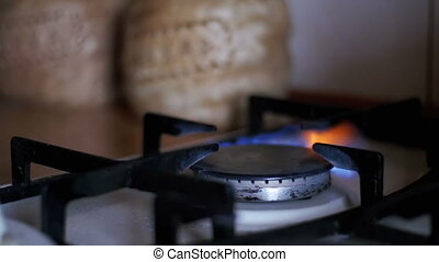 Ignition Of The Gas In The Burner On The Home Kitchen Stove. Slow Motion