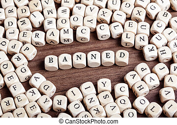 Banned, letter dices word - Word Banned in letters on cube...