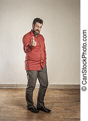 Pointing at you, confident adult European man with beard -...