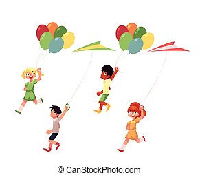 Kids, boys and girls, running with colorful kites, balloons