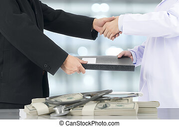 Businessman handshake to deal with the doctor.