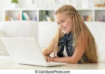 cute little girl using laptop - Portrait of a cute little...