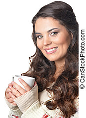 beautiful brunette woman drinking coffee, close up