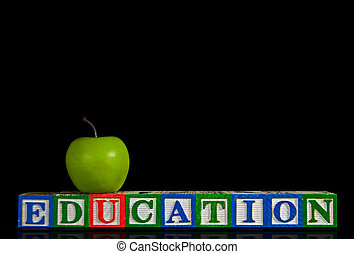 Educational Blocks - Apple on toy wooden blocks with...