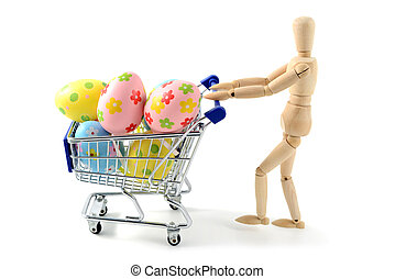 wooden mannequin shopping easter eggs in shopping cart on white isolated background