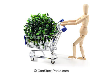wooden mannequin shopping with a cart on white isolated background