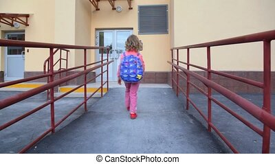 little girl using door intercommunication system - little...