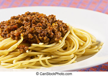 spaghetti bolognese served on white plate