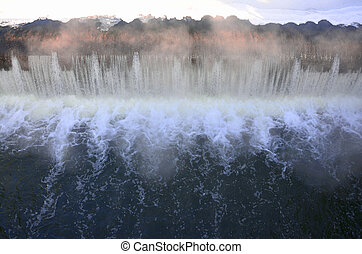 Falling water with strong bursts - Dam to regulate the water...