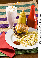 fast food - Cheeseburger with fries and strawberry milkshake