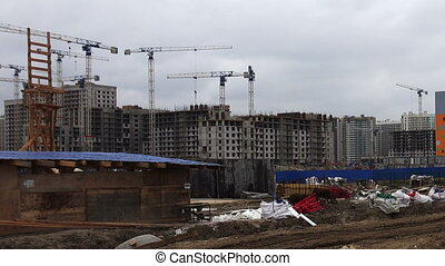 Construction of multi-storey house. Construction site.