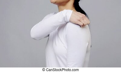woman suffering from pain in shoulder - people, healthcare...