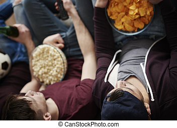 Directly above shot of men with snacks