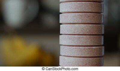 Columns of soluble purple tablets - Columns of soluble...