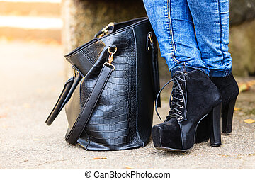 Female foot in elegant black shoes. - Female fashion. Part...