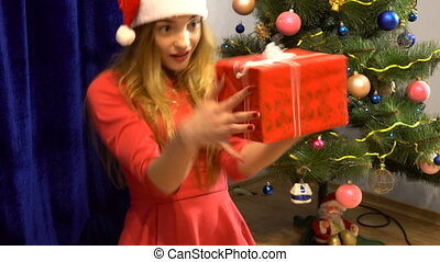 beautiful girl treats her new year's gift - girl treats her...