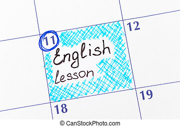 Reminder English lesson in calendar. Close-up.