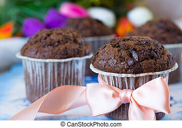 Chocolate muffin with pink bow - Chocolate muffins on the...