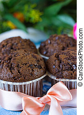 Four chocolate muffins with pink ribbon - Chocolate muffins...