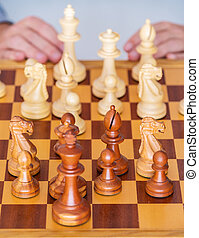 Middle game - the player thinks over position on chess Board...