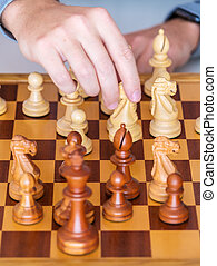 Middle game - the hand with knight makes a move on chess...