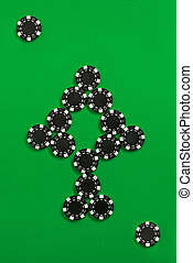 The poker chips on green background in the image of card or...