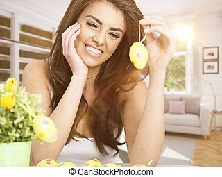 easter time. spring concept - young smiling woman holding an...