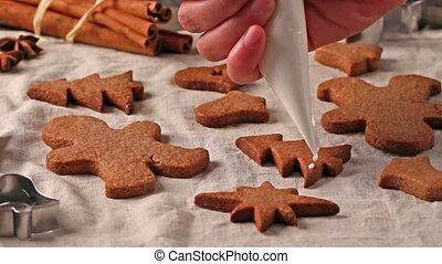 Making and glazing christmas cookies with cookie cutters