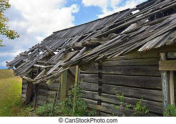 wooden rotten barn on autumn mountainside (Carpathian....