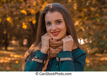 cute young girl with red lipstick on lips gripped the hands behind scarves and smiling close-up