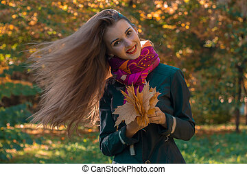 beautiful girl with long hair who fly on the wind keeps the...
