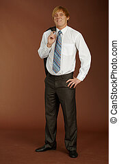 Young man on brown background - Young man standing on a...