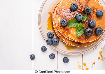Stack of pancakes with fresh blueberry and caramel syrup....