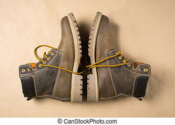 Unisex brown leather boots with yellow shoelaces