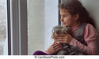 girl teen and dog sitting on a window pet sill windowsill -...