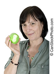 Aged woman with fresh apple