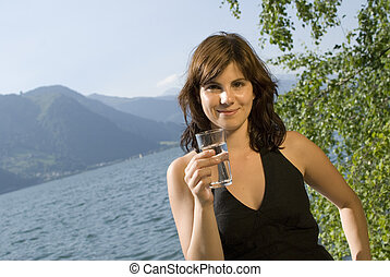 Girl with glass of water - Beautiful girl holding a glass of...