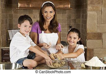 Mother, Son and Daughter Family In Kitchen Cooking and...