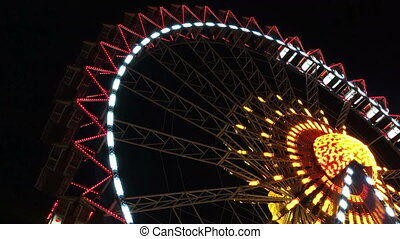 Ferris Wheel illuminated - video of an illuminated ferris...