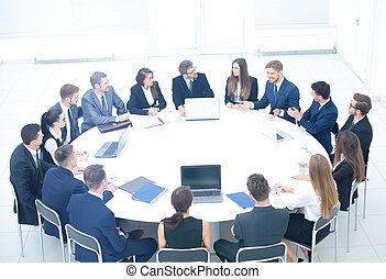 Investment Director holds a meeting with the business partners,