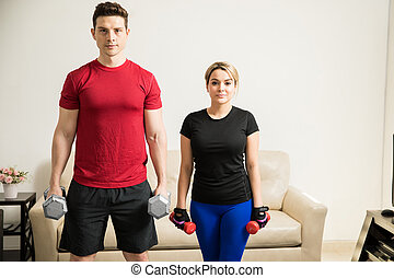 Young couple working out together - Portrait of a good...
