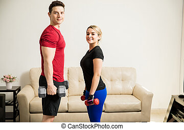 Training and lifting weights together - Portrait of a good...
