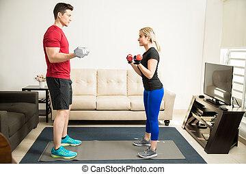 Couple lifting weights and working out - Full length...