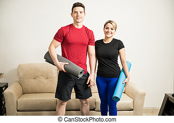 Cute couple ready to exercise at home - Good looking young...