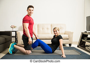 Latin couple working out at home - Full length view of a...